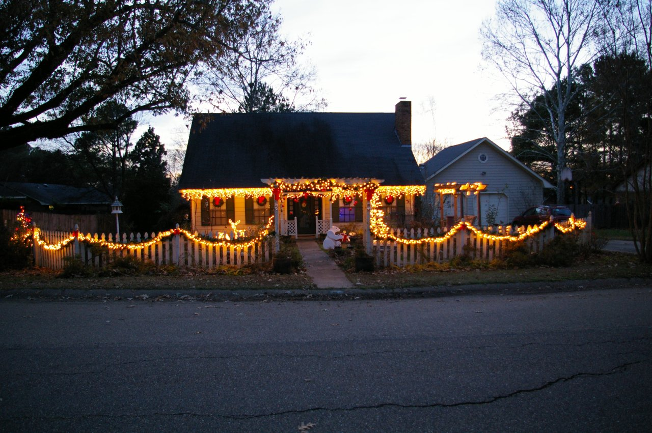 i decorate the arbor over the front walk with red ornaments and bows to give a splash of color - How To Decorate My Front Yard For Christmas